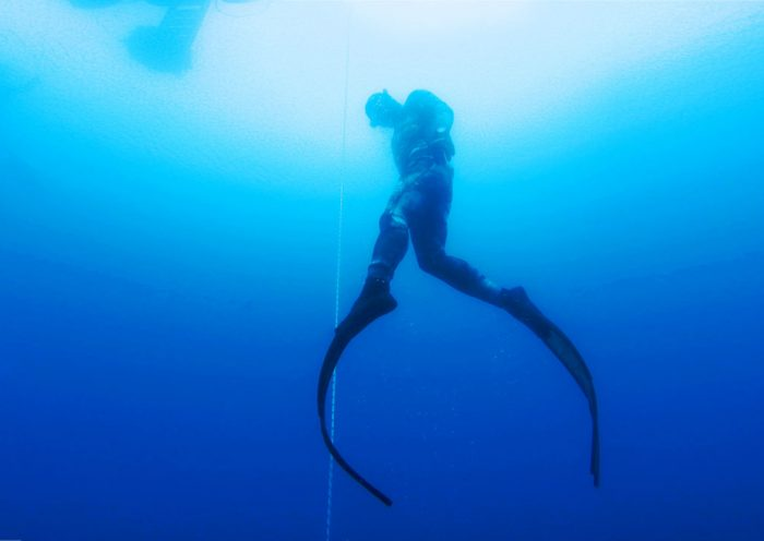 Freediver ascending to the surface
